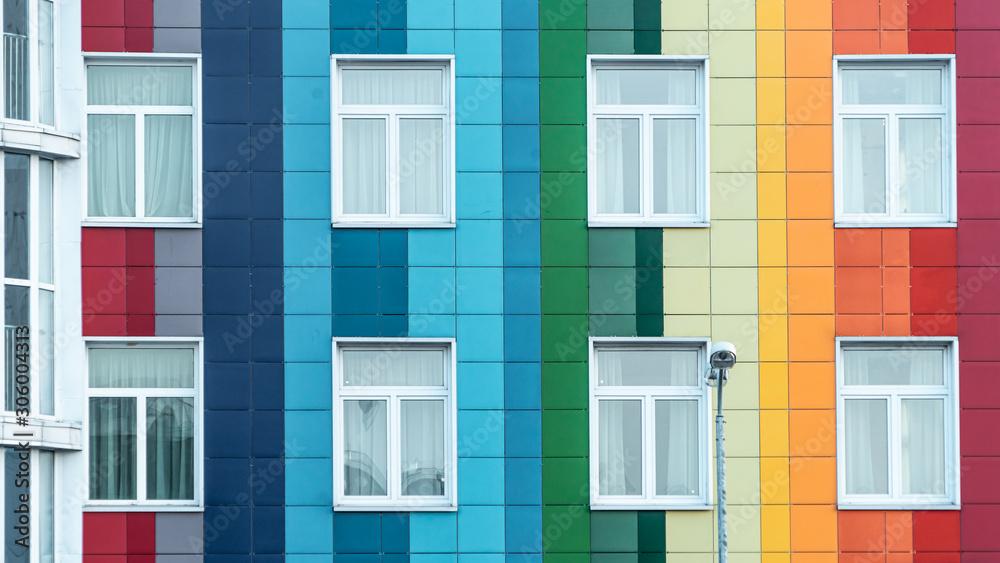 Fototapeta Modern bright rainbow facade of a kindergarten. Multicolor wall of a public building. Positive vibrant architecture.