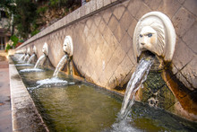 Old Venetian Fountain With Lion Heads Springs Pure Drinking Water In Spili, Crete Island, Greece