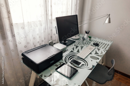 Tidy workstation with table, chair and technological devices