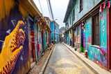 Fototapeta Uliczki - Colorful street art in the streets of Valparaiso, Chile