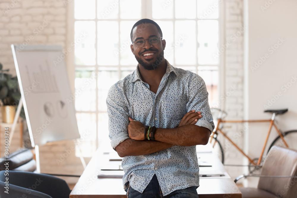 Fototapeta Smiling confident african american young businessman portrait.