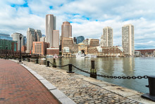 Boston Skyline With A Cobbled Harborside Path In Foreground On A Partly Cloudy Autumn Morning