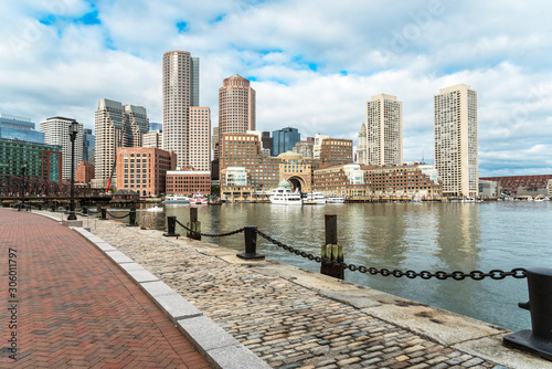 Boston skyline with a cobbled harborside path in foreground on a partly cloudy a Canvas Print