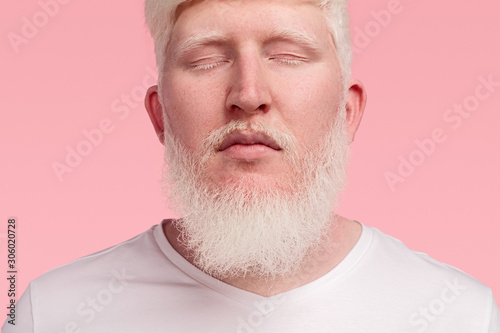 Calm adult albino man with closed eyes Canvas Print