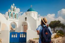 Santorini Island Traveler Exploring Greek Church Architecture In Akrotiri. Woman Tourist Walking During Vacation
