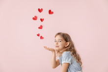 Cute Little Girl Sending Romantic Air Kiss On Color Background. Valentines Day Celebration