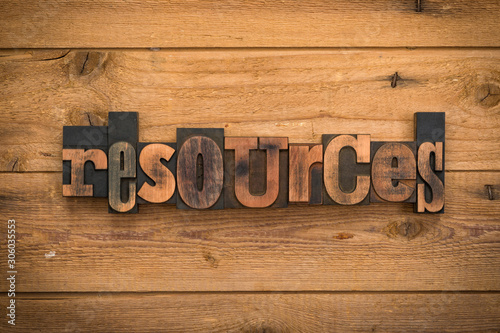 Vászonkép Resources, word written with vintage letterpress printing blocks on rustic wood