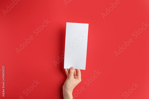 Fotobehang Vrouw gezicht Female hand with blank menu on color background