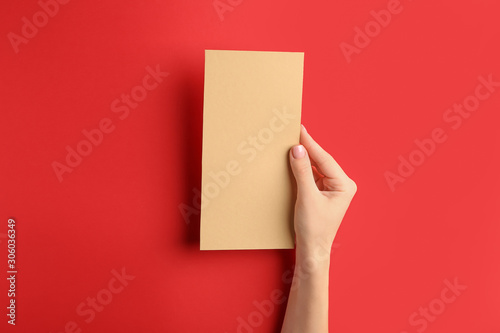 Recess Fitting India Female hand with blank menu on color background
