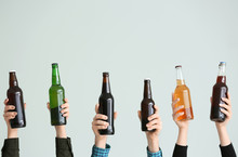 Hands With Bottles Of Beer On ...