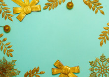Christmas And New Year Green Background With Gold Leaves. Festive Concept, Place For Text. Shot From Above. Beautiful Flat Lay.