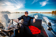 Fisherman On A Motor Boat With...