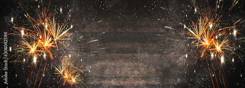 Silvester background panorama long - Firework on rustic brown wooden texture with space for text