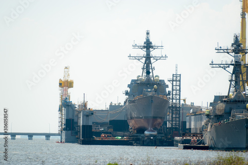 Photo The ship yard of Ingalls Shipbuilding with several military Navy war ships