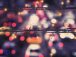 canvas print picture - Close up LED lighting and wire decoration over blur background of traffic light on street.