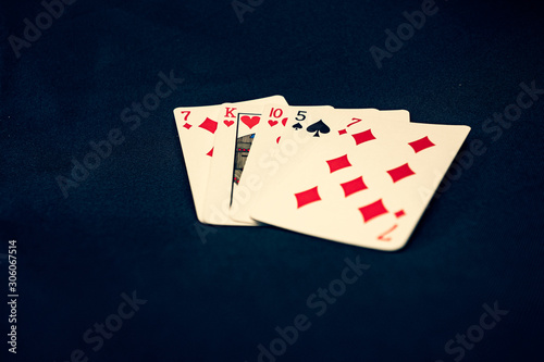 Tela Bad poker hand on black background