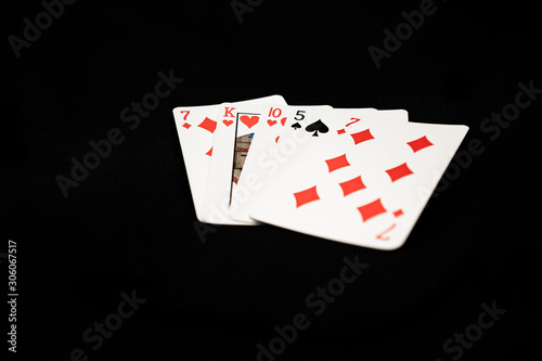 Fotografia Bad poker hand on black background