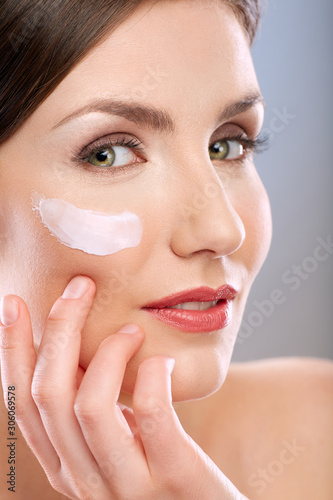 Fototapety, obrazy: Beauty portrait of woman with white cream on face.