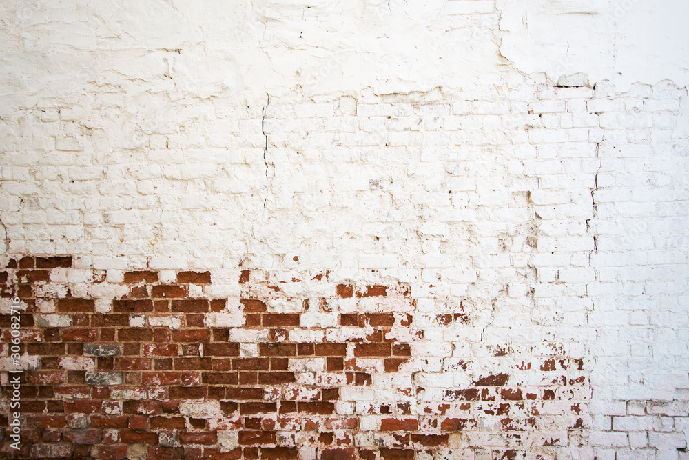 white painted aging brick wall
