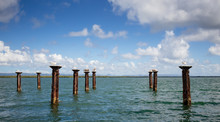 Boat Dock Pilings In Water Wit...