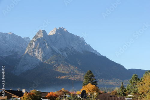 View of the Bavarian town of Garmisch Partenkirchen with moutains in the background on a sunny morning in Autumn