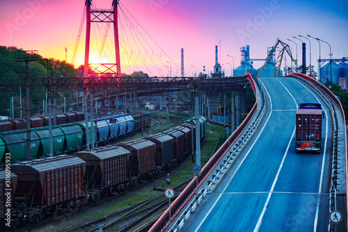 Fotografia, Obraz truck with container rides on the road, railroad transportation, freight cars in