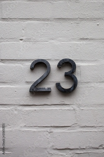 Fotografia number 23 on white wall
