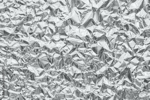 Shiny metal silver gray foil crumpled texture background