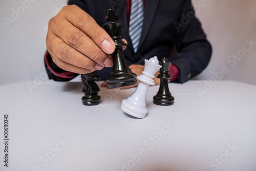 Spoed Fotobehang Rood, zwart, wit hand of businessman moving chess in competition, shows leadership, followers and business success strategies