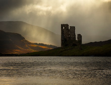 Loch Assynt Is Located Close To The Lovely Coastal Town Of Ullapoool In The North Of Scotland. At The Lake Stands The Beautiful Old Ruin Ardvreck Castle. Photo Was Taken Just After Sunrise.