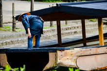 Man In Old Japanese Boat