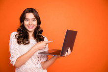 Portrait Of Positive Cheerful Girl Use Laptop Search Online Black Friday Bargain Point Index Finger Website Promo Wear Good Looking Clothing Isolated Over Shine Color Background