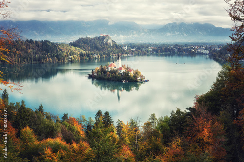 Fototapety, obrazy: Famous alpine Bled lake (Blejsko jezero) in Slovenia, amazing autumn landscape. Aerial view of the lake, island with church, Bled castle and Julian Alps from Mala Osojnica, outdoor travel background