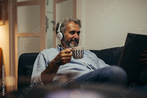 middle aged man relaxing at his home listening records Canvas Print