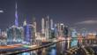 The rhythm of the city of Dubai near canal aerial timelapse