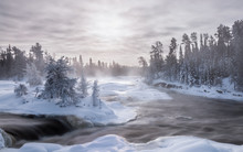 Ice Fog And Hoar Frost On A 30 Below Winter Morning At The Waterfalls On The Wabigoon River, Northwest Ontario, Canada.