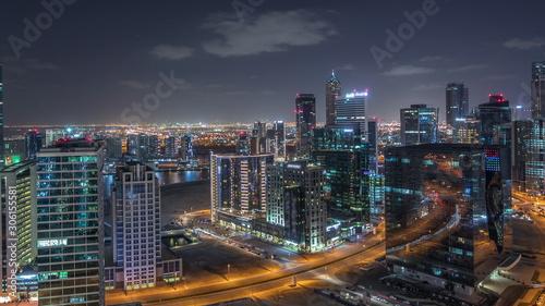 Fototapety, obrazy: Dubai's business bay towers aerial night timelapse.