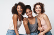 Portrait of gorgeous multiracial women standing together and smiling