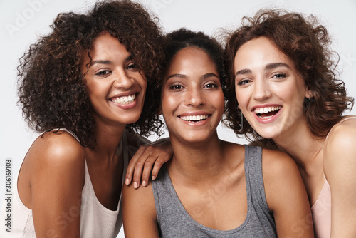 Fototapeta Portrait of young multiracial women standing together and smiling obraz