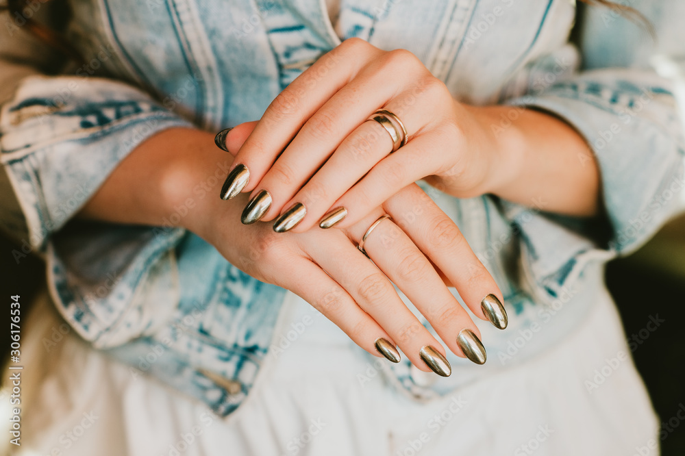 Stylish trendy female mirror manicure, metal nail art