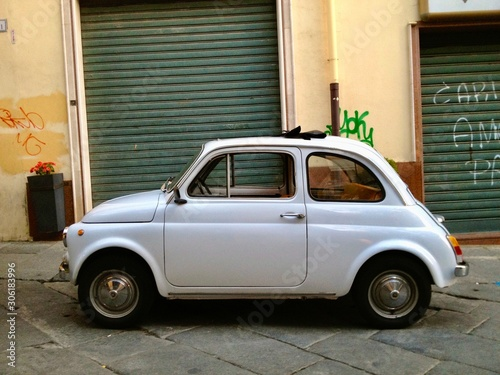 old fiat 500 in front of house Canvas Print