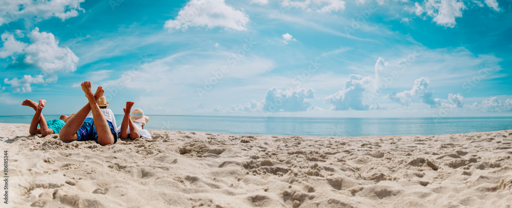 Fototapeta father with son and daughter relax on beach vacation, panorama