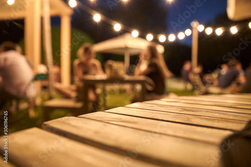 Платно view of a wooden table on the terrace of a bar