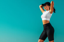 Individual Sports And Fitness Recreation. Sporty And Fit Young Woman Athlete Relaxed After Yoga Training On The Sky Background. The Concept Of A Healthy Lifestyle And Sport.