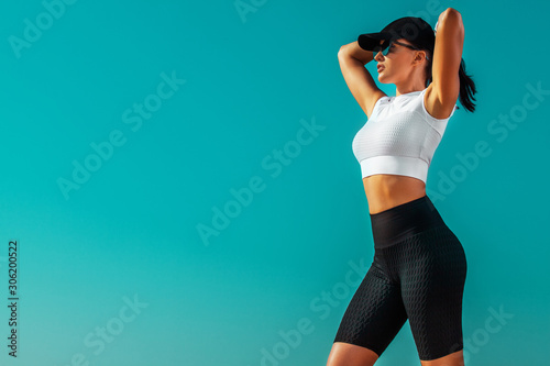 Fototapeta Individual sports and fitness recreation. Sporty and fit young woman athlete relaxed after yoga training on the sky background. The concept of a healthy lifestyle and sport. obraz