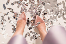 Pair Of Feet At A New Year's Eve Countdown Party With Confetti On The Floor, Top View