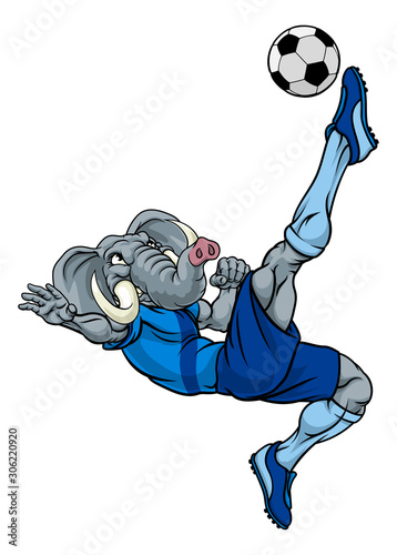 An elephant soccer football player cartoon animal sports mascot kicking the ball Canvas Print