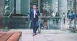 Asian entrepreneur leaning on street fence