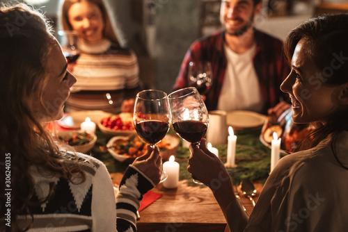 Canvas Print Photo of nice joyful people drinking wine and having Christmas dinner