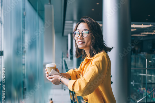 Half length portrait of cheerful hipster girl in classic glasses smiling at came Canvas-taulu